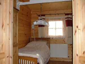 Hampton Court Holiday Park - bedroom with ceiling track hoist