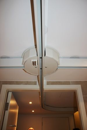 Dorsett Hotel, ceiling track hoist in bathroom.