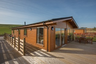 The Chalet, Dunbar. Accessible accommodation with a ceiling track hoist.
