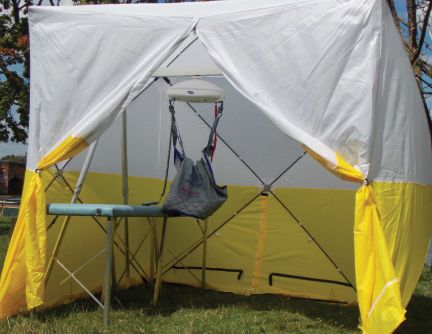 A fully set-up MigLoo with changing bench and a gantry hoist. It also comes with a commode.